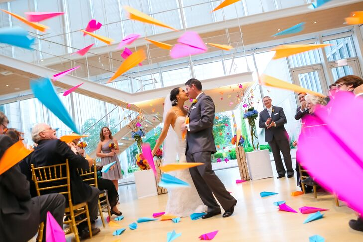 Everything about Maria (34 and a physician) and Jeff's (40 and in corporate insurance) wedding had the wow factor. With bright colors around, the Mode