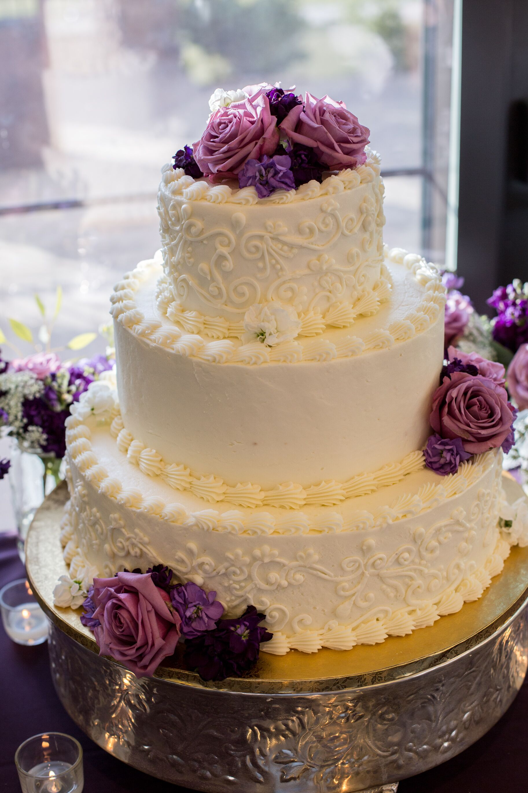 white wedding cake with purple flowers three tier white wedding cake purple flowers 27416