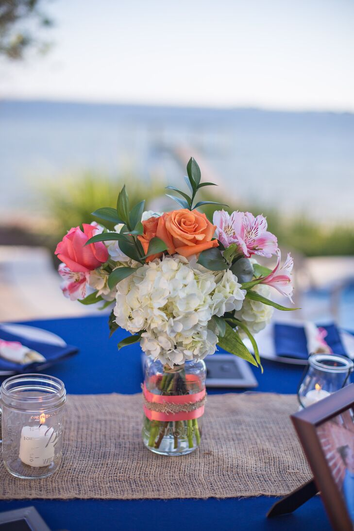 Hydrangea rose and orchid mason jar centerpieces
