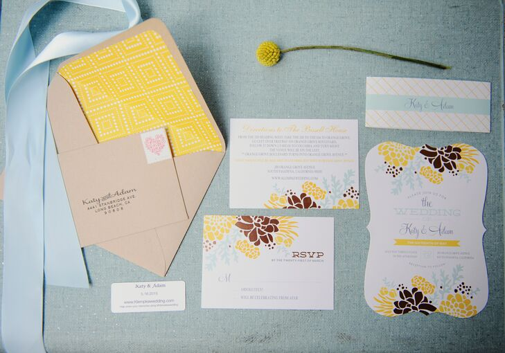 The white invitations printed with yellow, brown and light blue floral designs reflected the day's garden-inspired vibe.