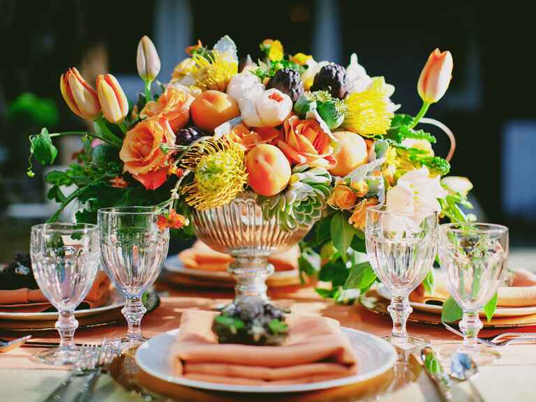 Autumnal tulip reception centerpiece in pedestal vase