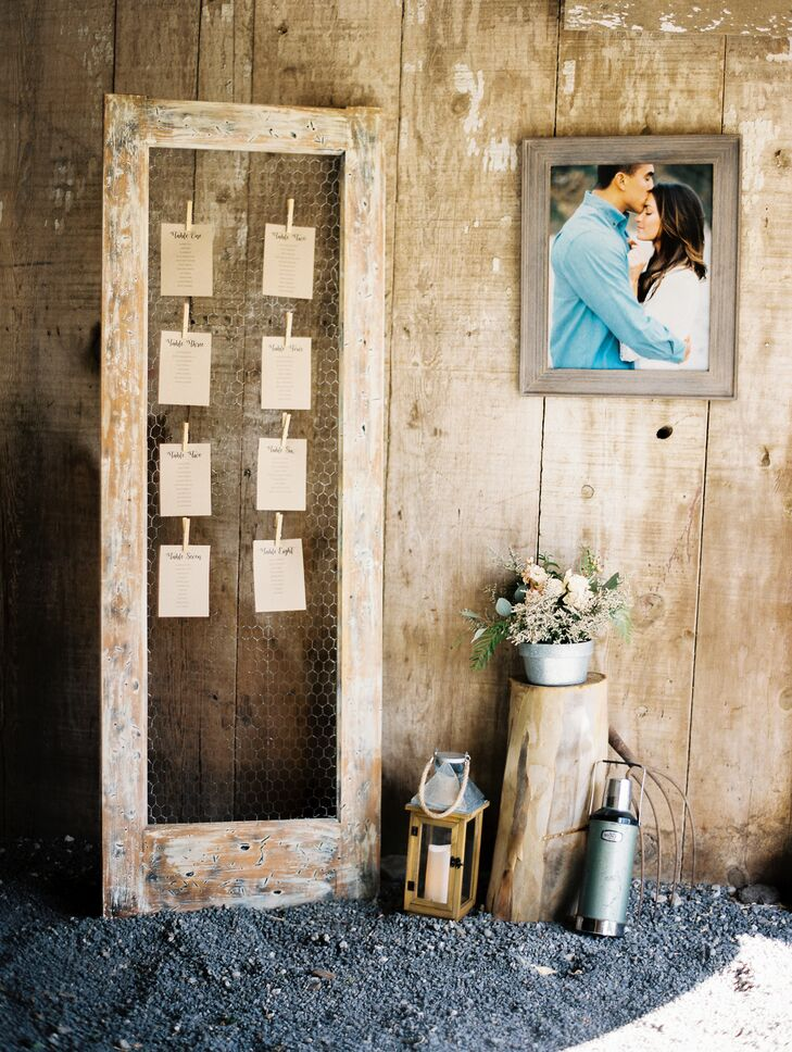 Guests found their seating assignments on papers clipped to wood-framed chicken wire.
