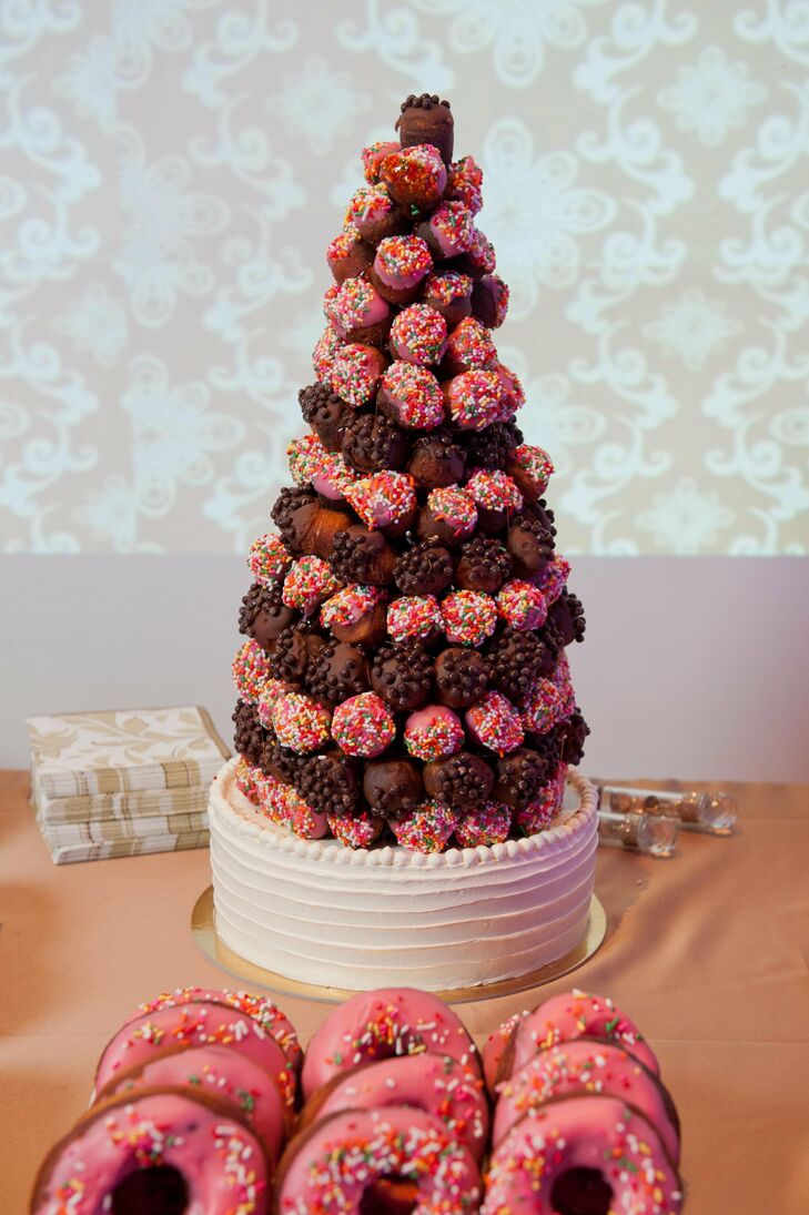 Instead of a traditional wedding cake, Gloria and Emmanuel asked their baker to arrange donut holes in a croque-en-bouche style.