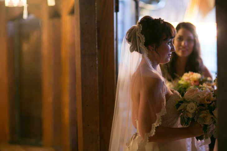 For the ceremony, Rachel added a traditional lace-edged veil to her classic low updo.