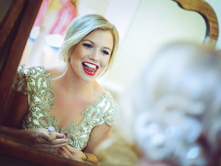 bride putting on lipstick