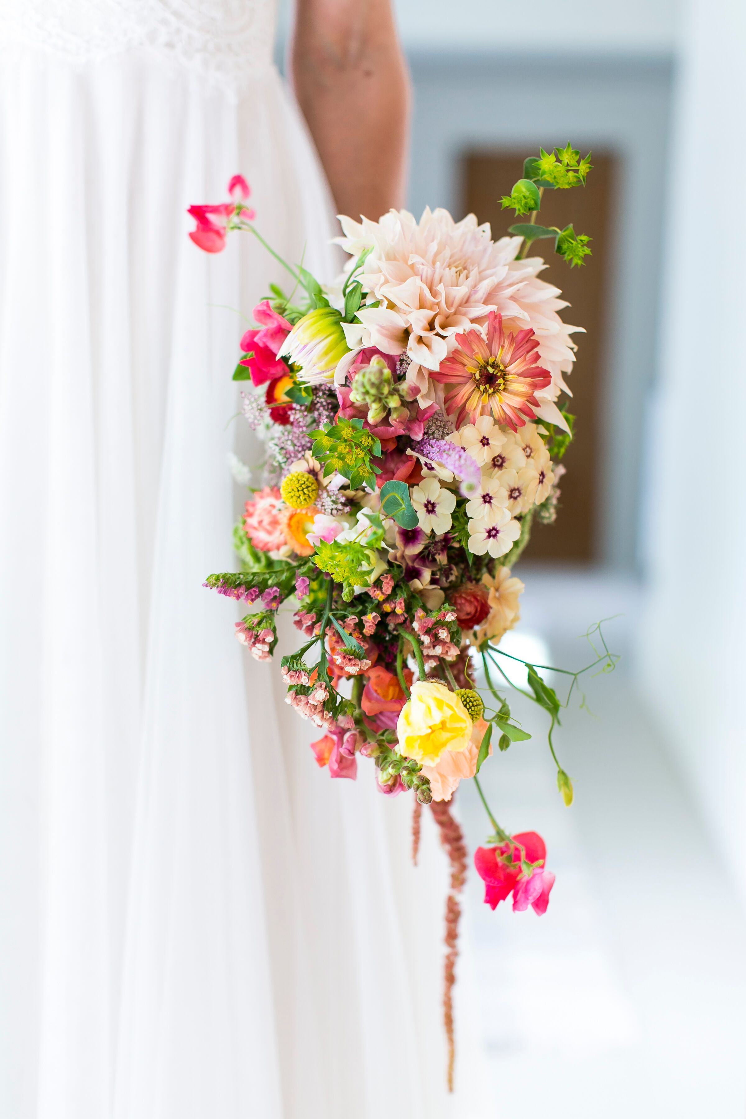Cascading Pink Dahlia Sweet Pea And Wildflower Bouquet