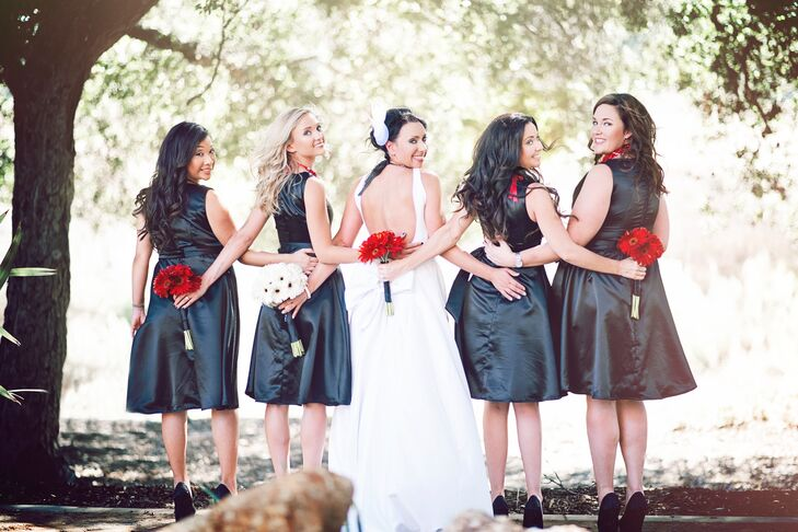 """Dianna chose Gerbera Daisies as her flower of choice,"" says Mike. ""Her bouquet was styled with white daisies and the bridesmaids with red, all wrapped in black with small pearls."""