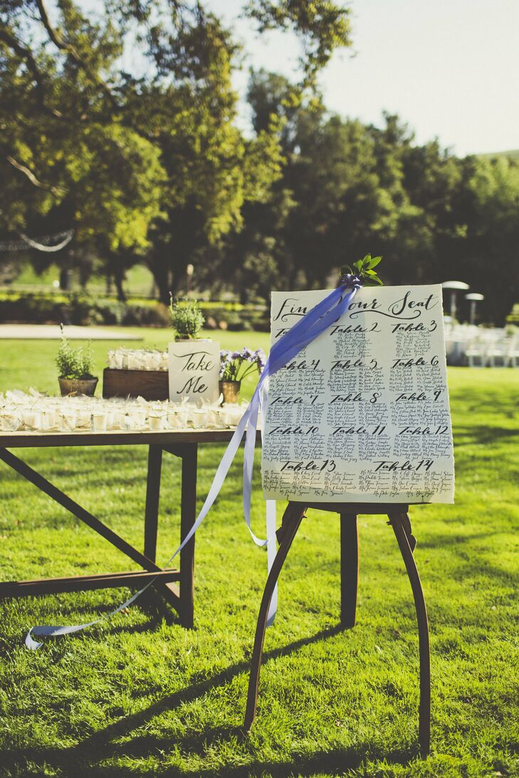 Guests found their seats by finding their name on an elegantly calligraphed seating chart displayed on a vintage easel.