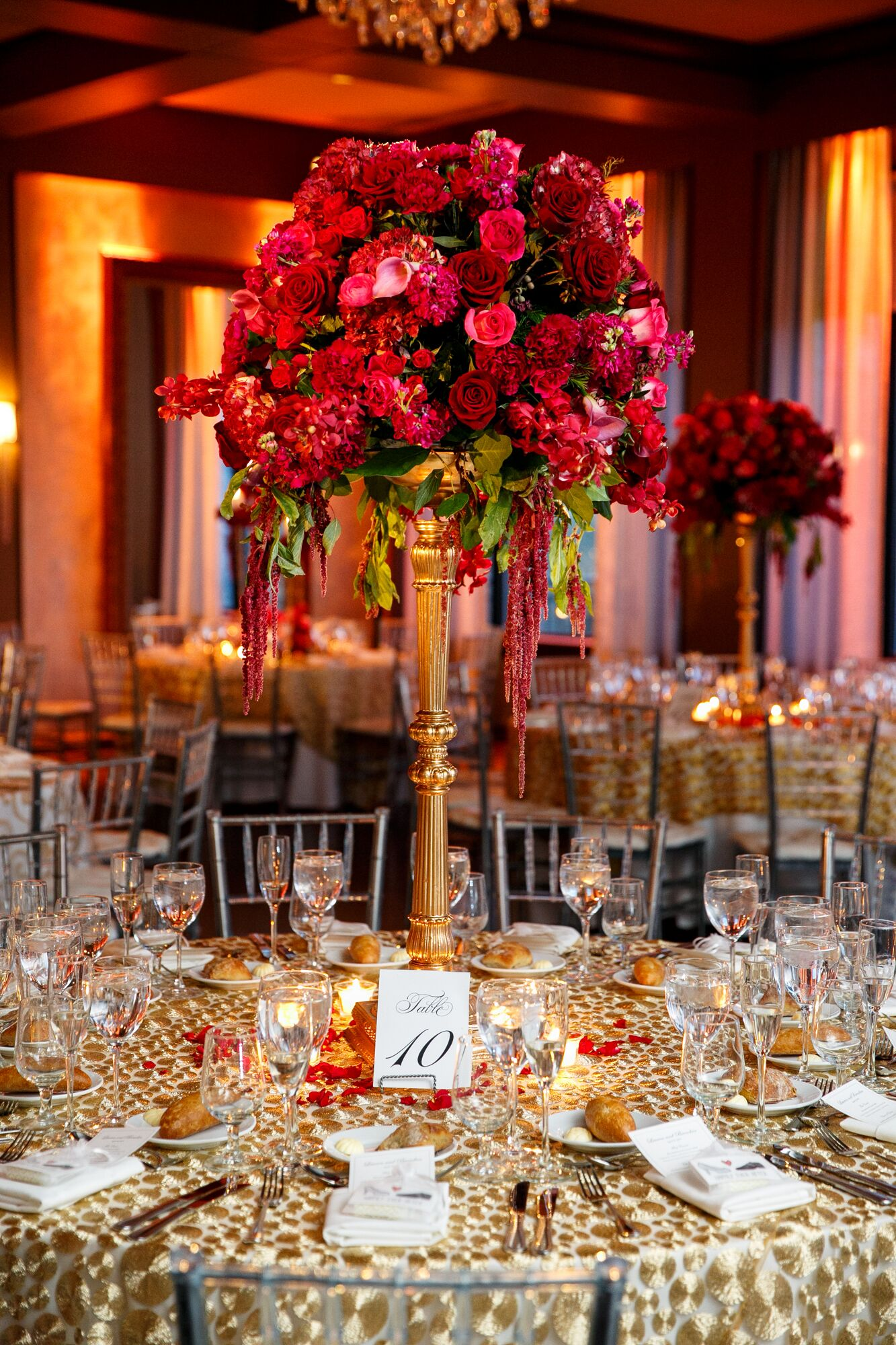 Elaborate red rose centerpiece on gold stand for Table jardin beauty