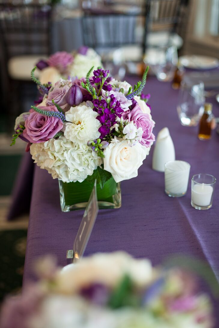 Purple and white rose centerpieces