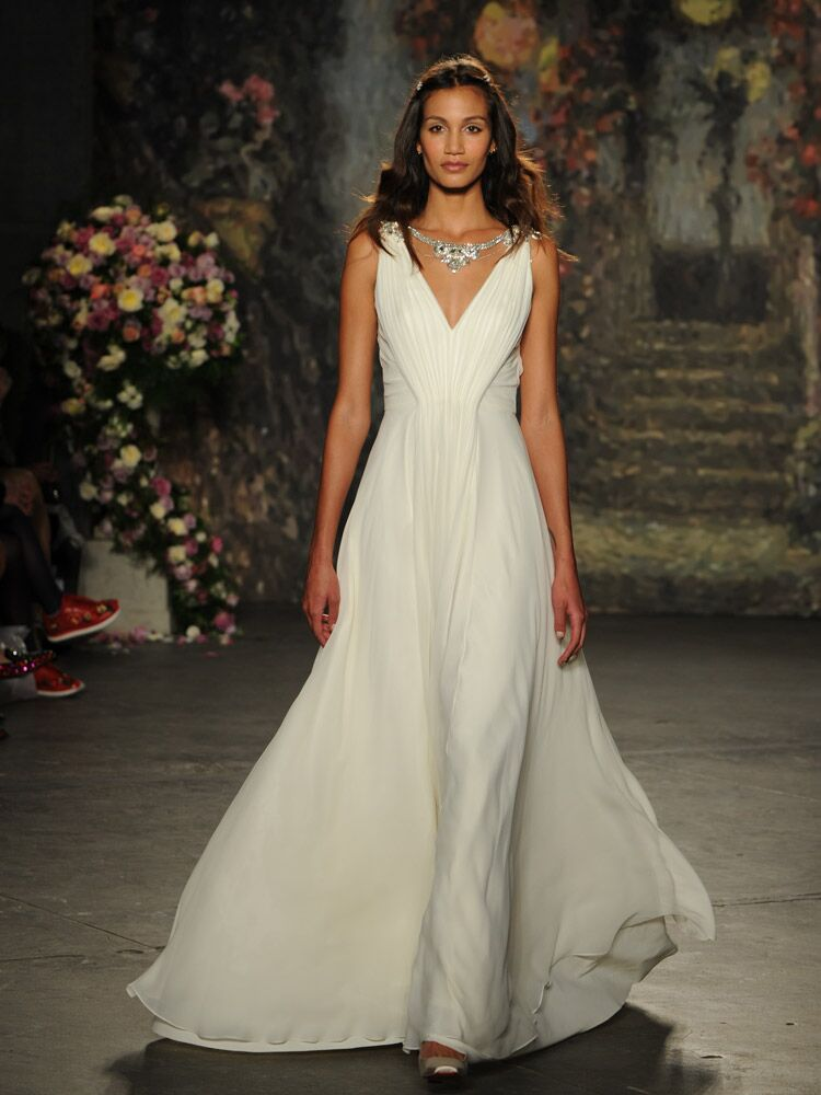 Jenny packham debuts wedding dress collection for bridal fashion week jenny packham deep v neck wedding dress with beaded necklace from spring 2016 junglespirit