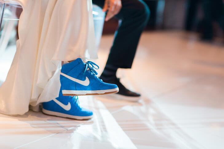 bride wearing blue wedge sneakers