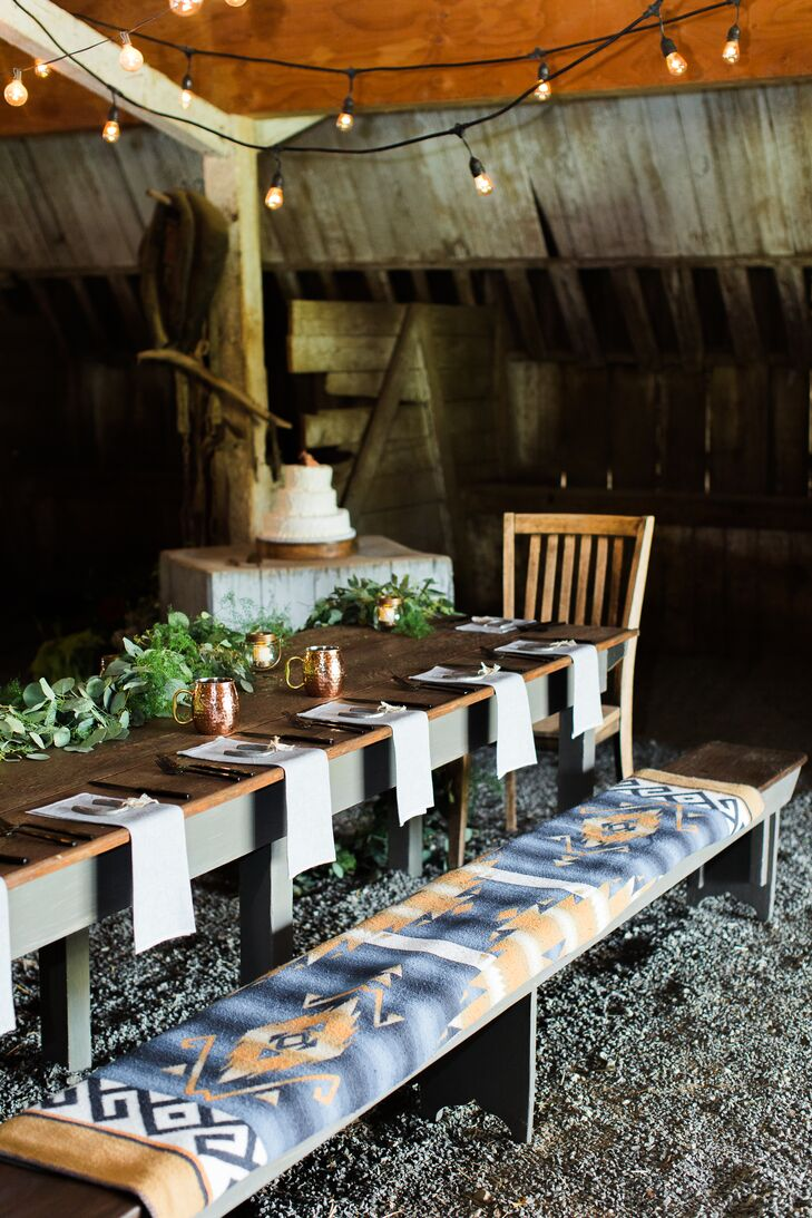 At the barn reception, long farm-style tables were topped with simple green centerpieces, and falsa blankets cushioned the bench seating.