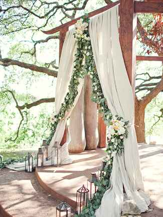 Fabric covered arbor with eucalyptus garland
