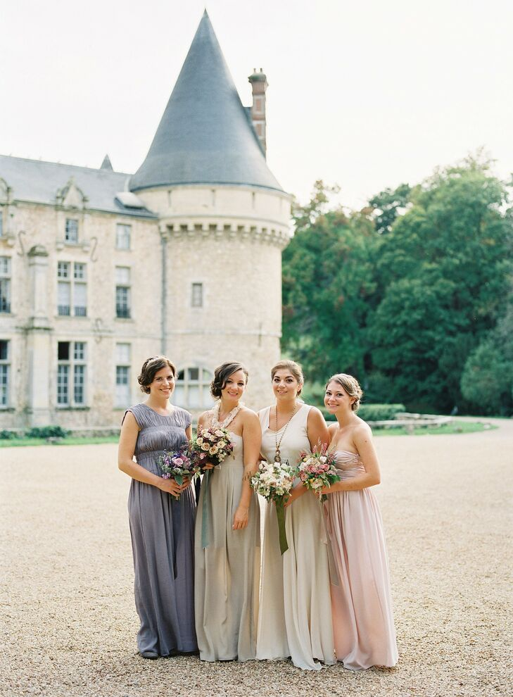 Each bridesmaid had their own specific dress and style. I wanted  the bridesmaids to reflect our undefined color story in its effortless mix, so I chose a soft palette of ivory, nude, blush pink and lavender gowns, bringing in pops of dark romantic color in the headpieces and jewelry, Jessica says.