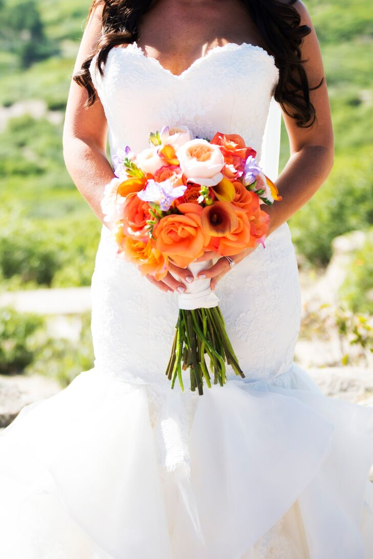 Cara carried an orange bouquet of roses, calla lilies and garden roses.