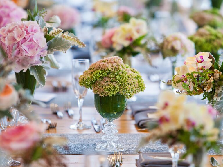 9 ways to save on wedding flowers wedding reception floral arrangements in colored glassware junglespirit Images