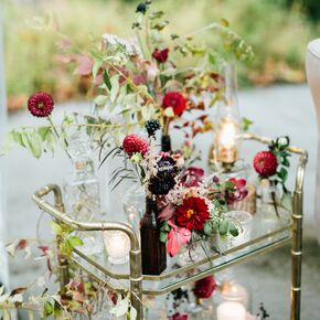 Rustic wedding centerpieces bar cart with fall blooms and vintage dcor junglespirit Gallery