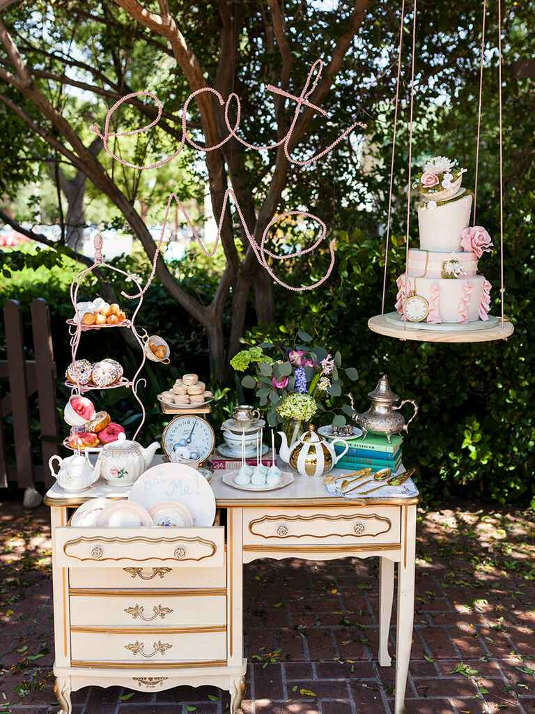 'Alice in Wonderland' inspired cake display and dessert table