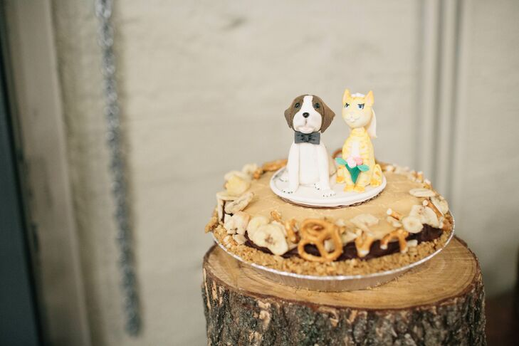 """I was lucky enough to have so many talented friends who contributed to our wedding in amazing ways,"" the bride says. ""A friend from college has a cake-making business and made us a Saint Bernard and orange cat cake topper that paid homage to our cat, Chuck. They sat on top of a Fat Elvis pie and it was so 'us'."""