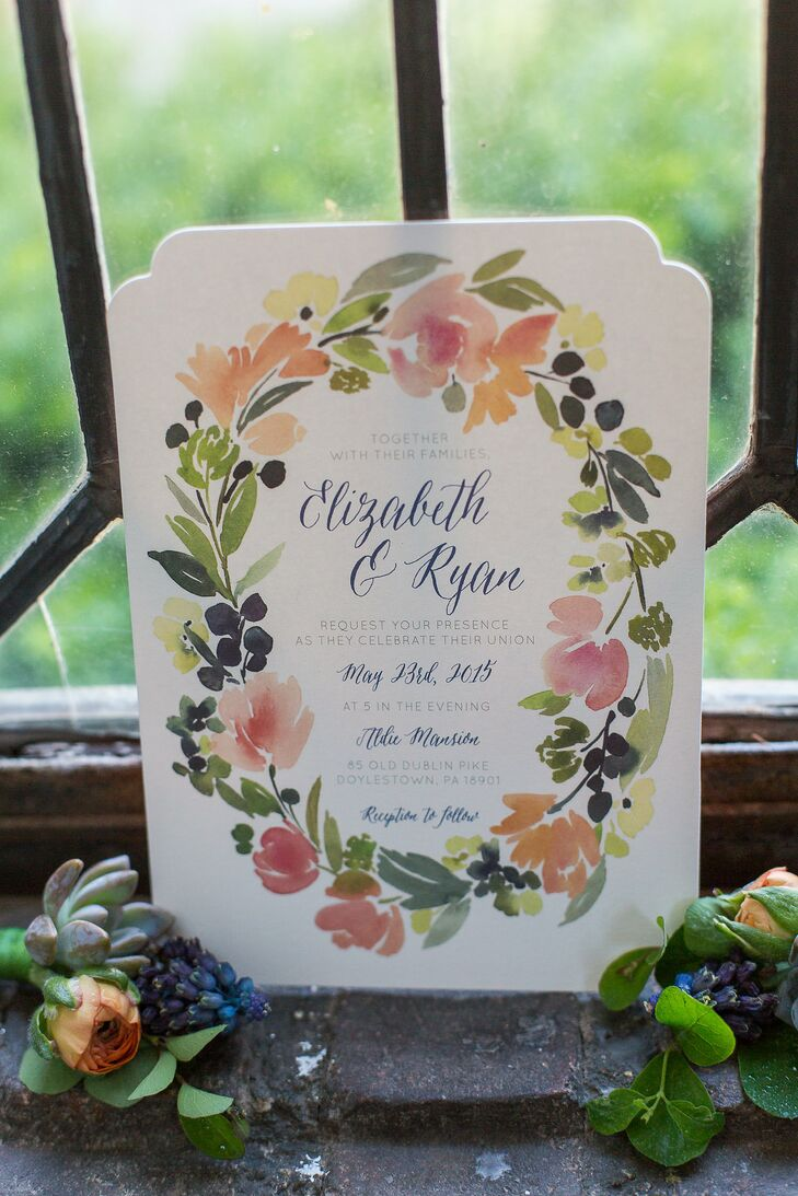 Liz and Ryan got their wedding invites from Minted. The invites featured a floral watercolor border that wreathed the script.