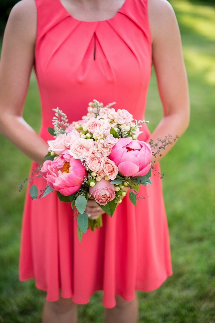Union Street Flowers created bridesmaid bouquets using closed pink peony, blush-colored roses, hypericum berries and assorted greenery.