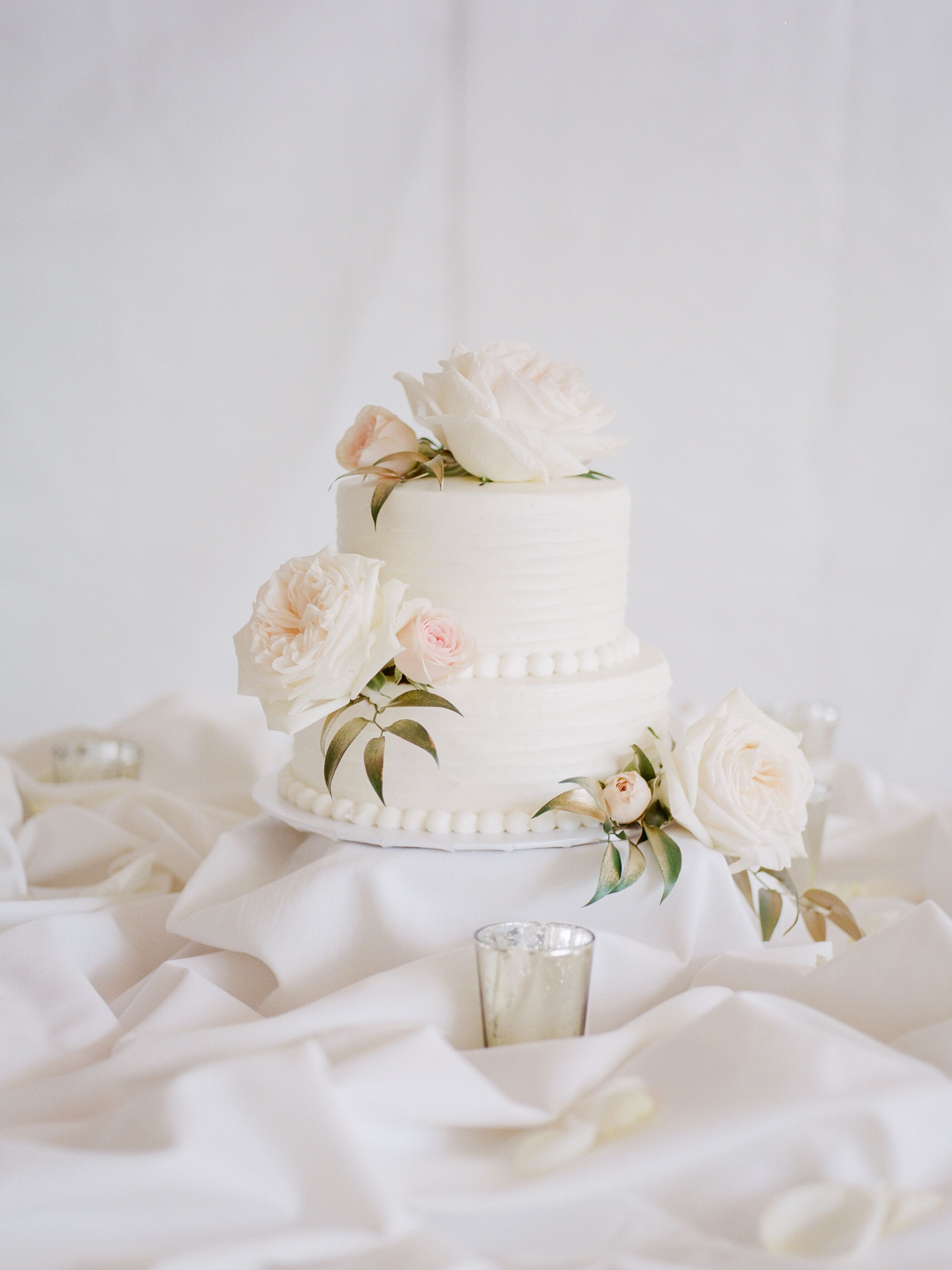 Two Tier White Wedding Cake With Lush Roses