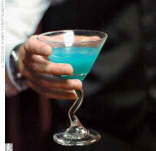 blue martini in a glass with a zig zag stem