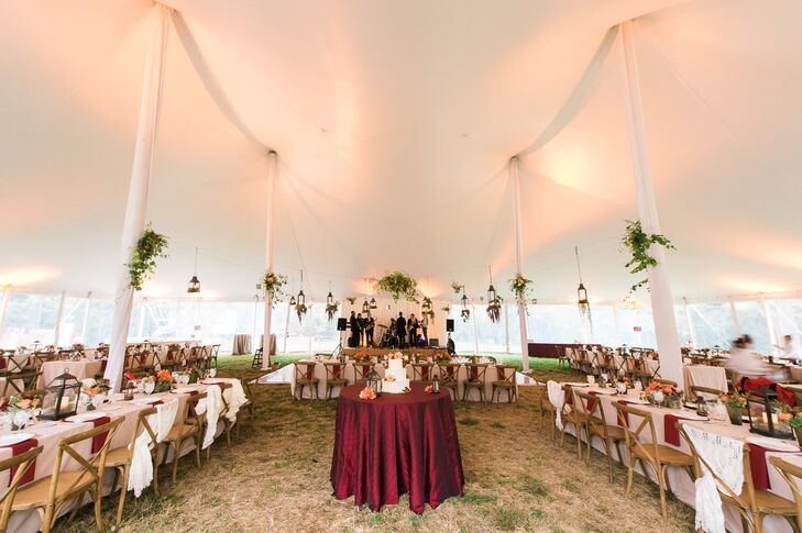 The reception took place underneath the white tent set up on the Woodlawn property. Long dining tables dressed in white linens surrounded the single round table, holding up the gorgeous cake.