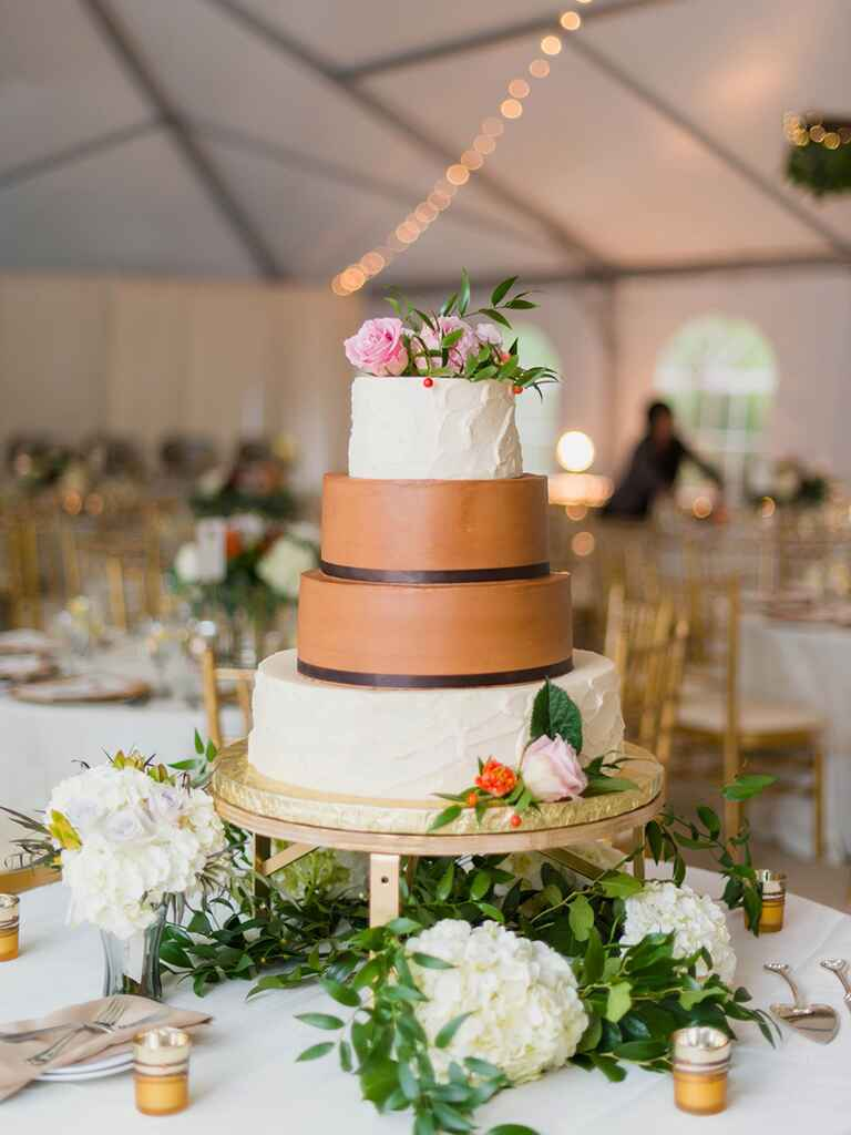 Four-tier chocolate cake with caramel fondant and vanilla buttercream frosting