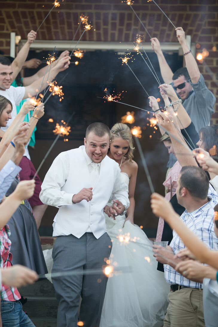 The newlyweds weds exited under sparklers carried by their loved ones.