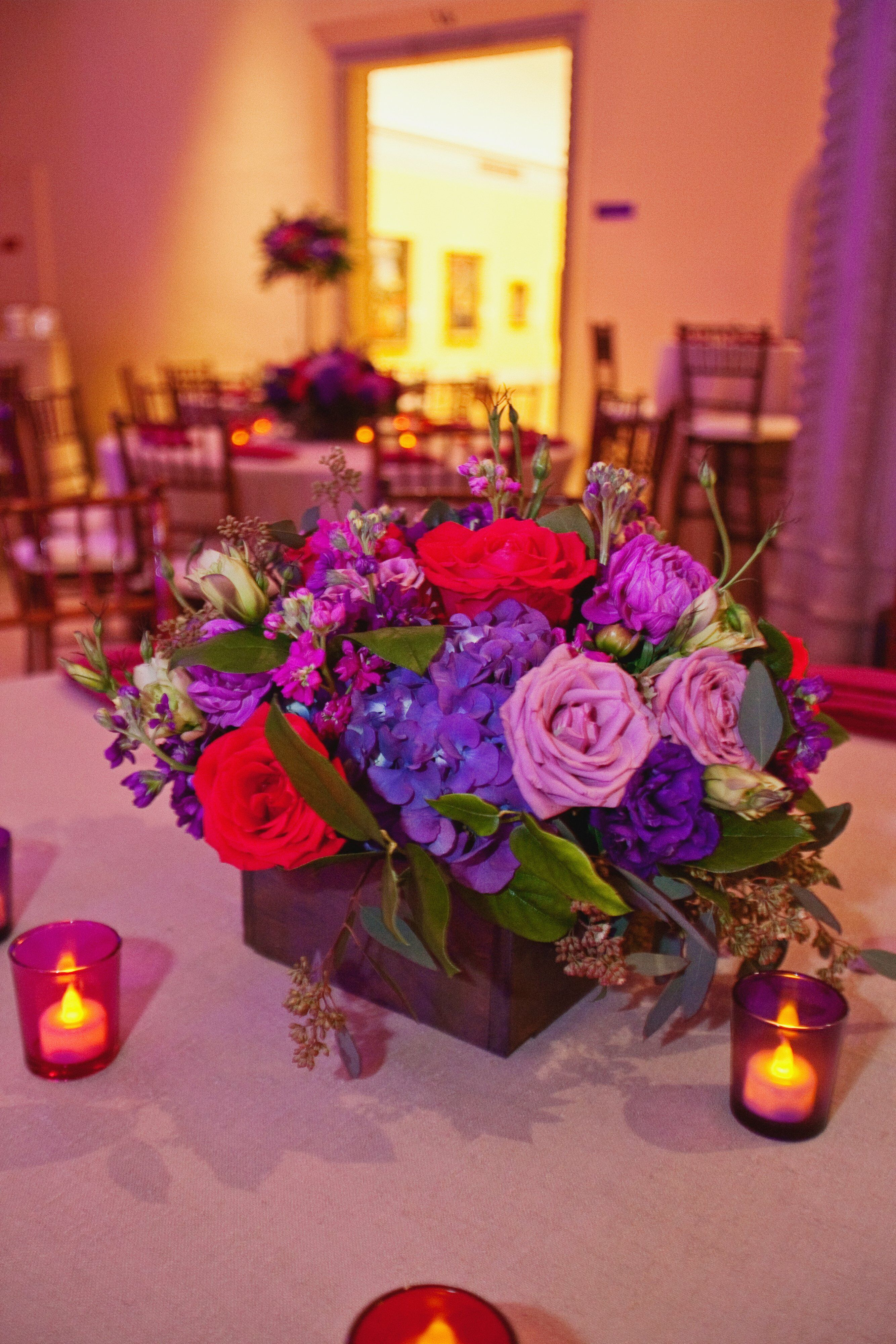 Small purple and red centerpieces