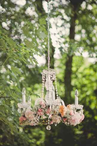 Outdoor chandelier with garland of roses and baby's breath