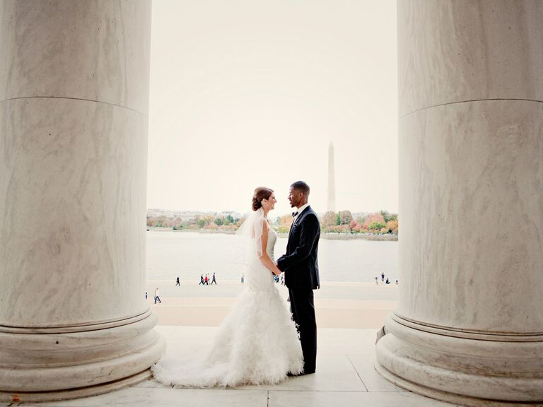 Newlyweds on steps of a monument in DC