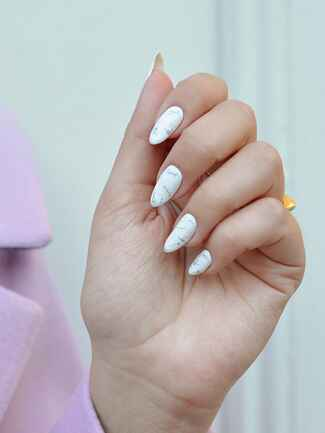 Marlbled nail idea for a wedding manicure
