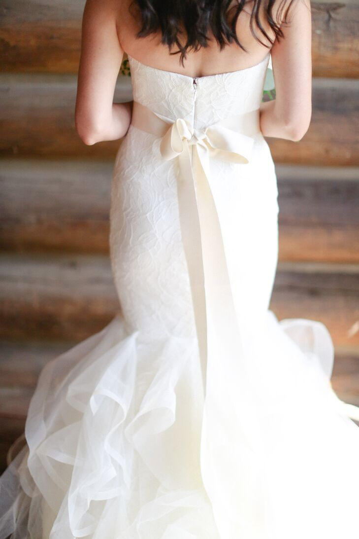 Nicole added a blush sash to her a Chantilly lace mermaid gown for the reception.