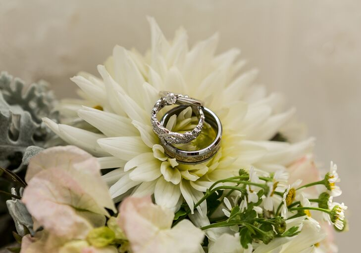 Engagement and wedding rings were placed on top of ivory flowers.