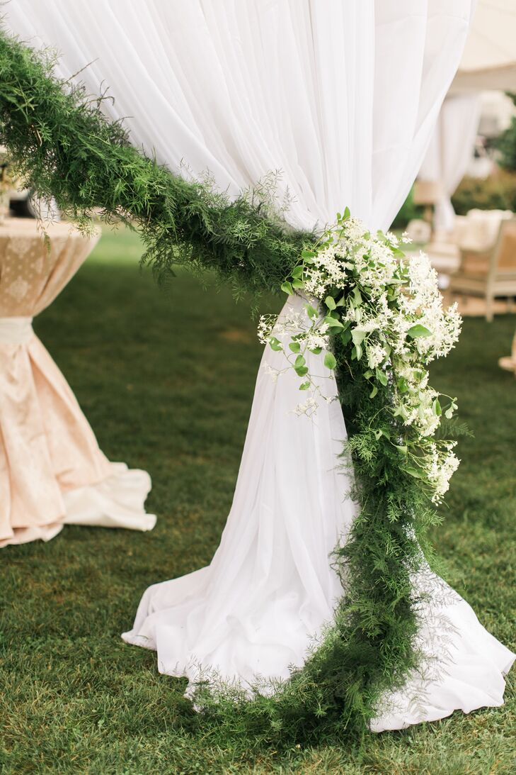 Green garland accenting a tented reception