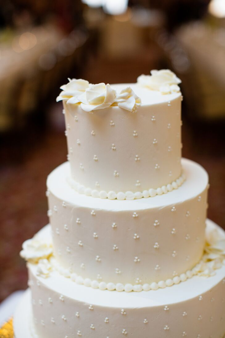 White fondant flowers and pearls on tiered white cake mightylinksfo