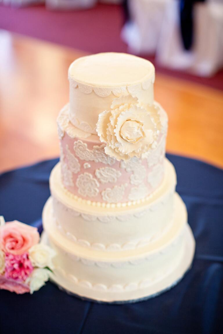 Buttercream wedding cake with lace decorations