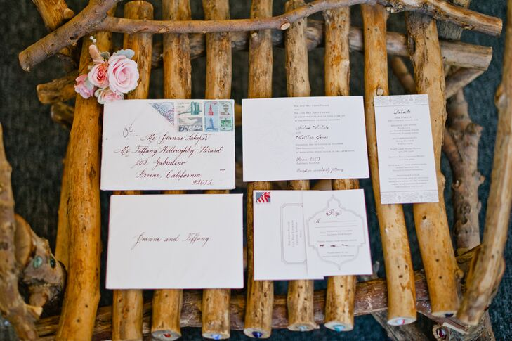 "The wedding invitations set the tone for the rest of the stationery, with their understated vintage design carrying through to the place cards, menu cards and ceremony programs. Elegant borders and hand-lettering lent the paper goods a note of old world charm and whimsy. ""One of my favorite design elements were the vintage stamps on the outer envelopes,"" says Annie."