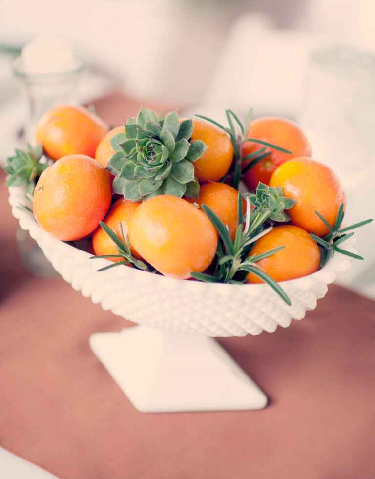 Clementine, rosemary and succulent wedding centerpiece