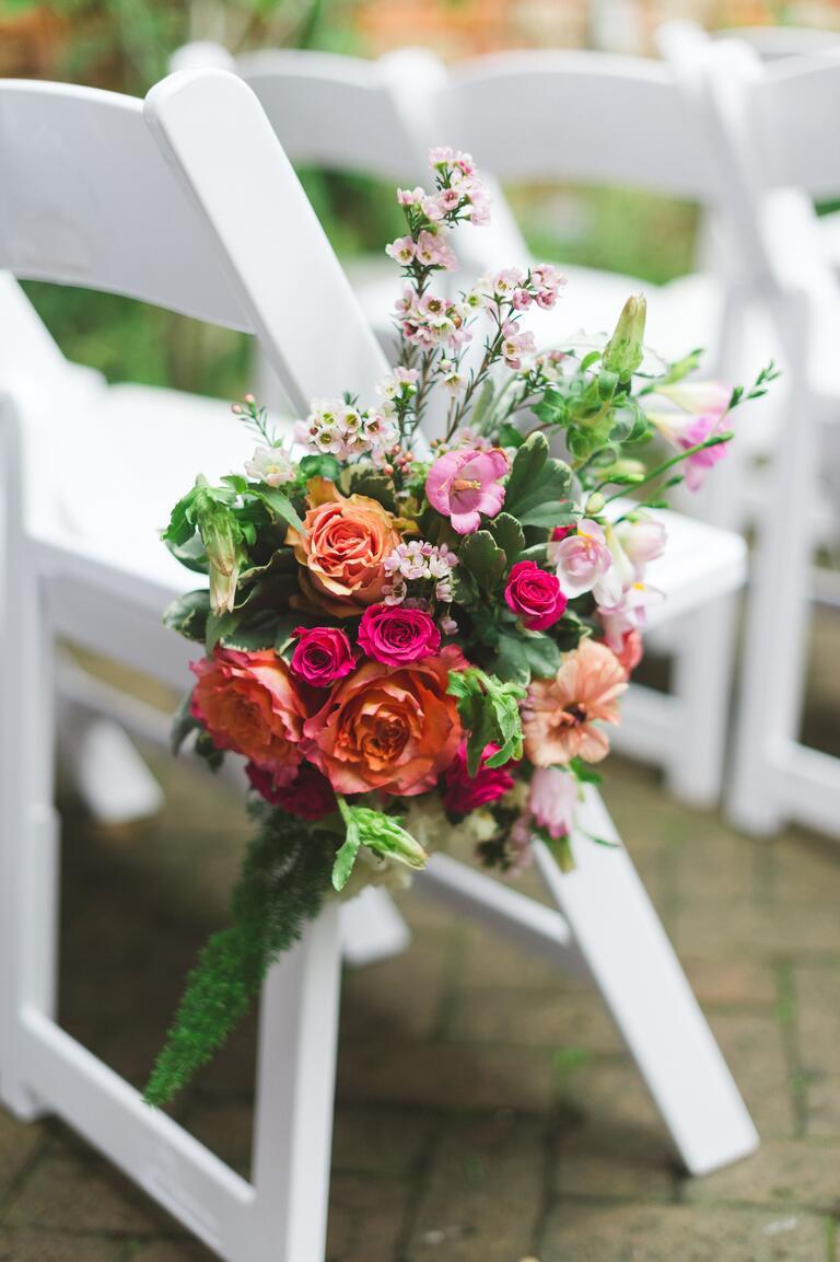 Colorful flower bouquets for aisle decor