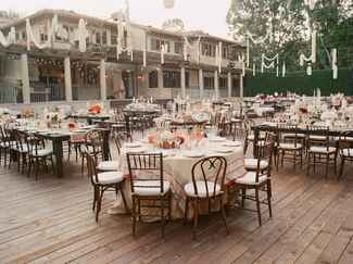 Outdoor wedding reception with white flower garland decor