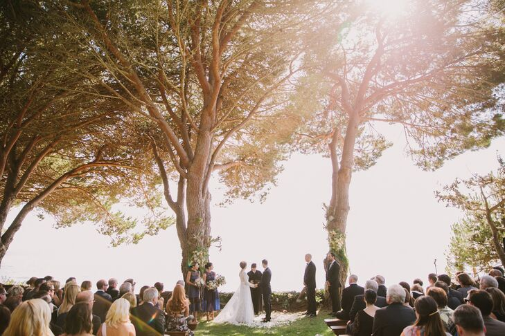 Rory and Kevin wed under an natural archway of two pine trees on the private Paion Estate in Big Sur, California.