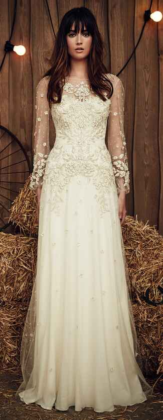 Jenny Packham Spring 2017 Apache ivory wedding dress with intricate botanical design and floral appliques on the bodice and tulle, long sleeves