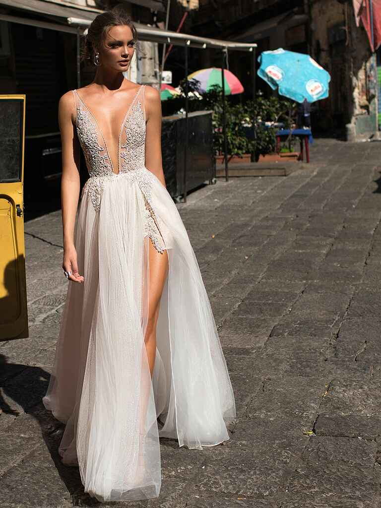 Wedding dress with plunging neckline and high side slit