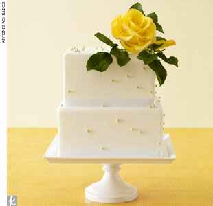 Square fondant wedding cake with yellow rose topper