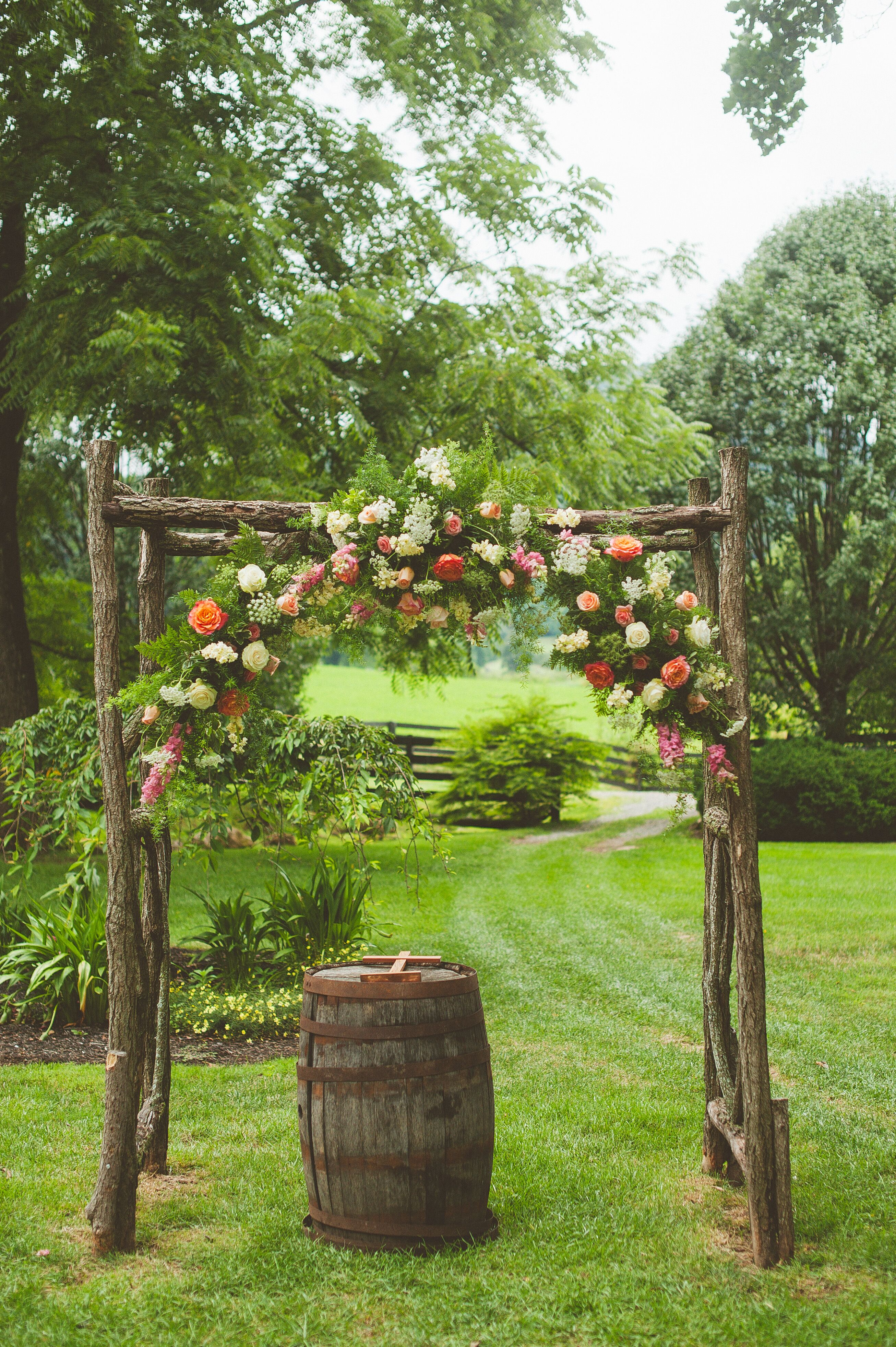 Wooden Wedding Arch With Coral Flowers