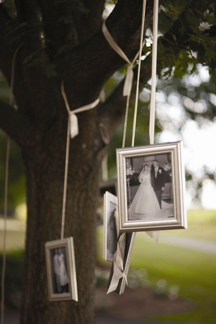 Paige and John took the phrase family tree literally, and hung vintage marriage photos of family members from trees near the ceremony location.